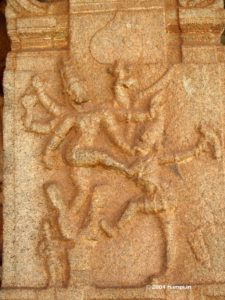 Watching by the side of the fearsome Narasimha is Prahlada
