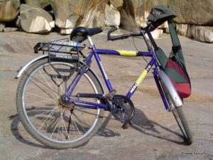 Rent a bicycle at Hampi. They are both fun and efficient way to explore this large ruins site.